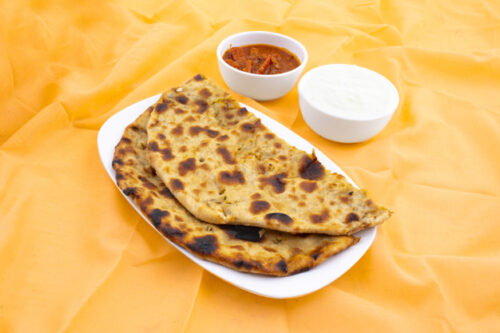 indian breakfast dish aloo paratha served with curd pickle 55610 3091